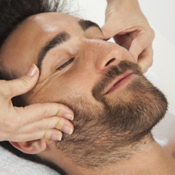 smiley-man-during-face-massage_23-2147638156