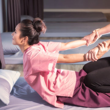 stretching-back-hands-by-thai-massage_33842-1691