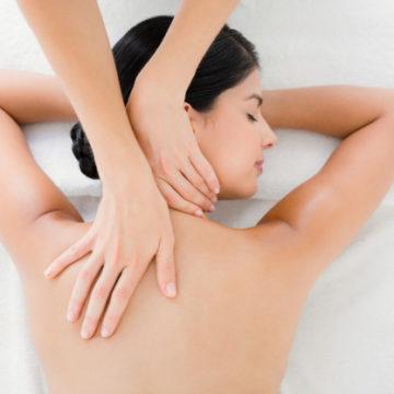woman-receiving-back-massage_13339-146288