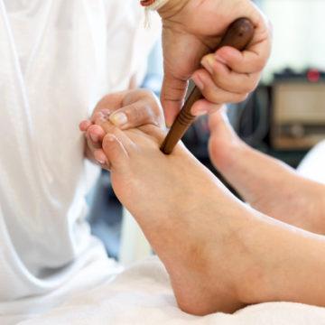 woman-receiving-reflexology-foot-massage_42667-105